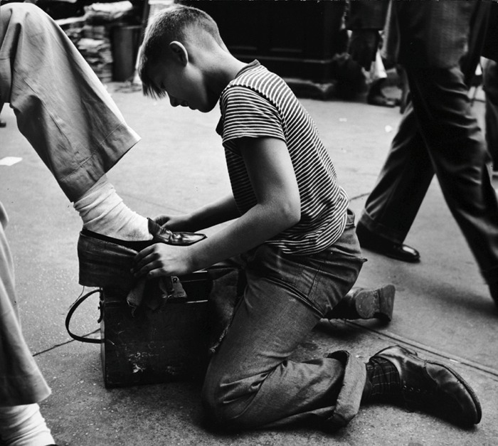 Shoeshine boy at work ©Leon Levinstein