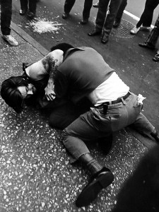 Two Men Fighting In a Crowd