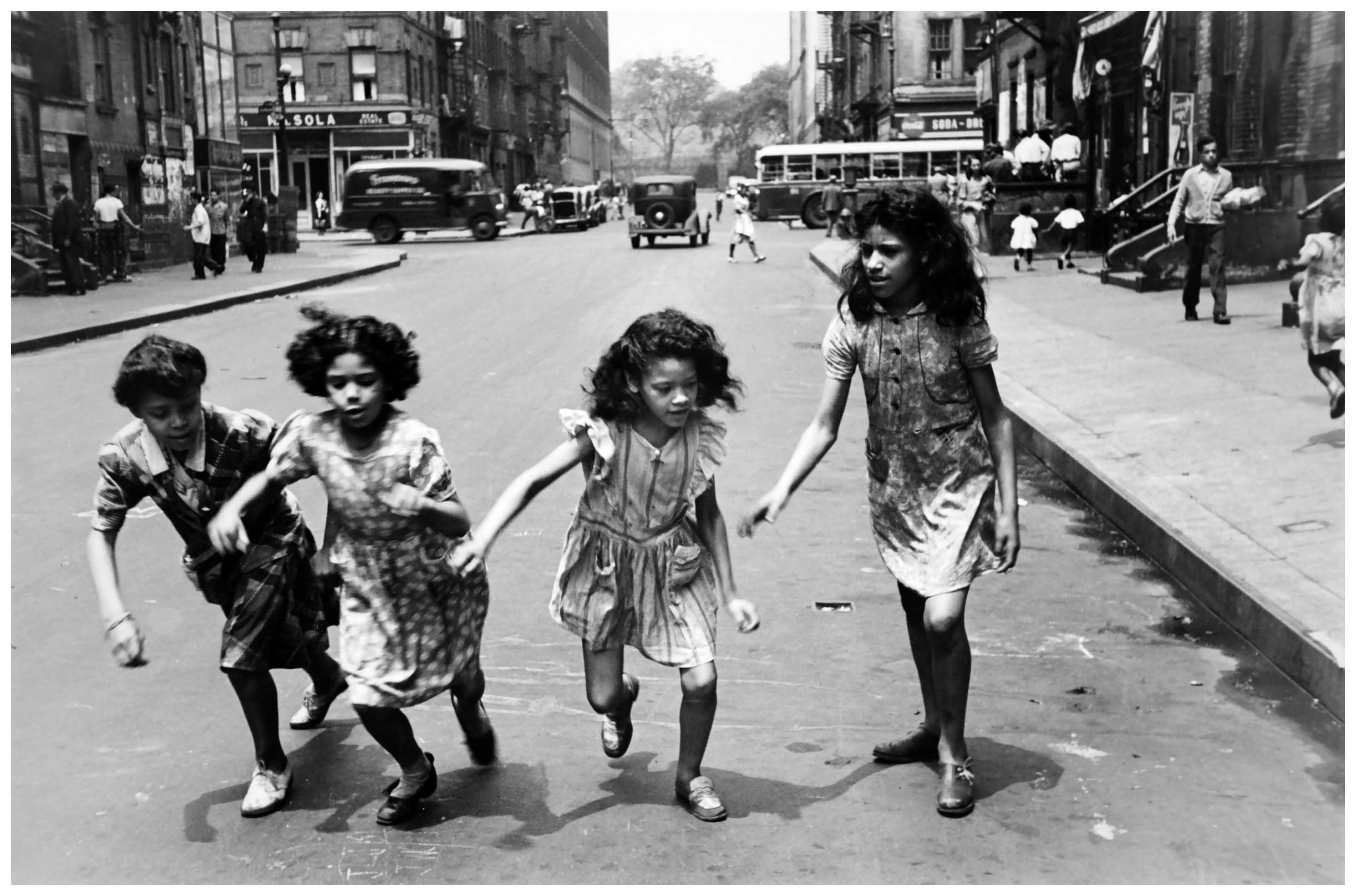 Four girls running in the street